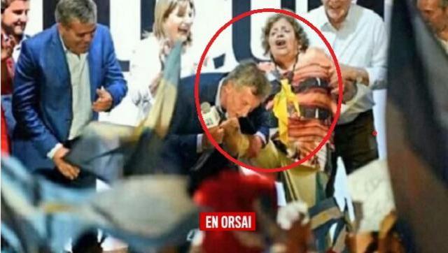 Habló la mujer: se acerco a Macri, le robaron el zapato y el le besó los pies